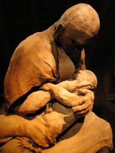 statue of a mother nursing a child